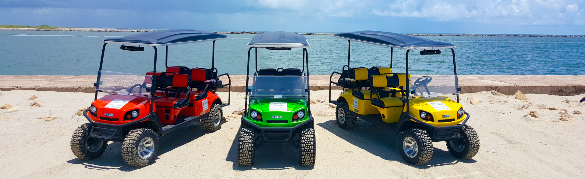 3 golf carts from Silver Sands Golf Cart Rentals at the Port Aransas jetty